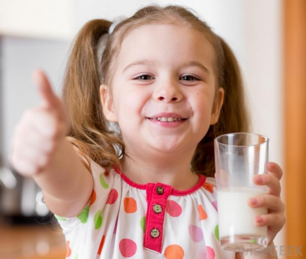 girl-in-polka-dot-shirt-drinking-milk